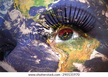 womans face with planet Earth texture and angolan flag inside the eye. Elements of this image furnished by NASA. - stock photo