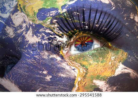 womans face with planet Earth texture and arizona state flag inside the eye. Elements of this image furnished by NASA. - stock photo