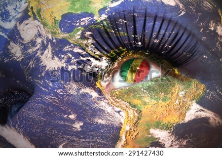 womans face with planet Earth texture and congo flag inside the eye. Elements of this image furnished by NASA. - stock photo
