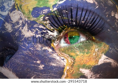 womans face with planet Earth texture and guinea bissau flag inside the eye. Elements of this image furnished by NASA. - stock photo