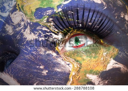 womans face with planet Earth texture and lebanese flag inside the eye. Elements of this image furnished by NASA. - stock photo