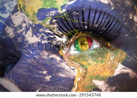womans face with planet Earth texture and malian flag inside the eye. Elements of this image furnished by NASA. - stock photo