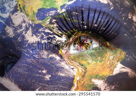 womans face with planet Earth texture and maryland state flag inside the eye. Elements of this image furnished by NASA. - stock photo