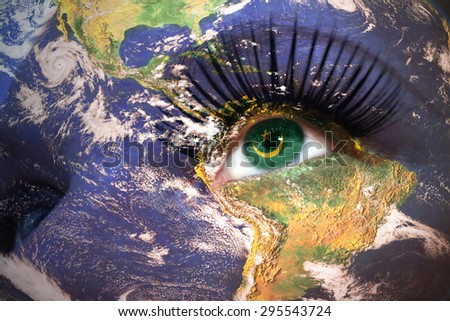 womans face with planet Earth texture and mauritania flag inside the eye. Elements of this image furnished by NASA. - stock photo
