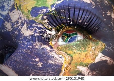 womans face with planet Earth texture and south africa flag inside the eye. Elements of this image furnished by NASA. - stock photo