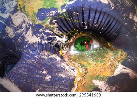 womans face with planet Earth texture and zambian flag inside the eye. Elements of this image furnished by NASA. - stock photo