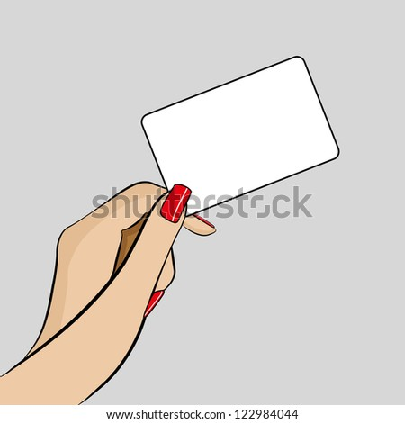 Womans hand holding a business card - stock photo