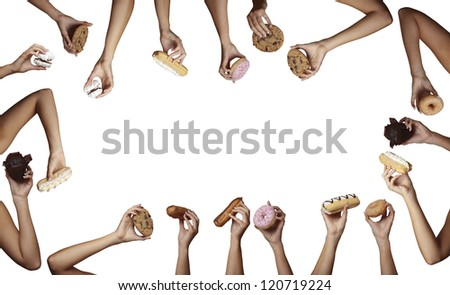 womans hand holding different cream cakes on white cut out background - stock photo
