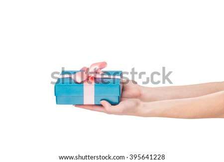 womans hands holding giftbox tied with bow - stock photo