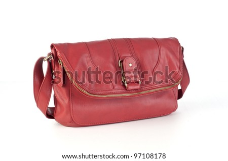 Womans red leather purse with strap, white background