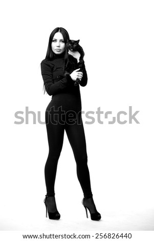 Women and cats. black and white photo. The hidden nature of women walking alone. a symbol of independence. Passion and sexuality, danger and desire. - stock photo