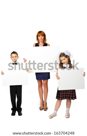 women and children hold a poster, studio, white background - stock photo