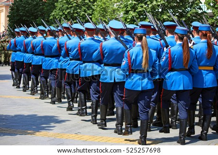 women and men guard soldiers marching with rifles