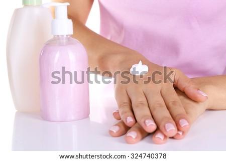 Women applying cream on her hands closeup - stock photo