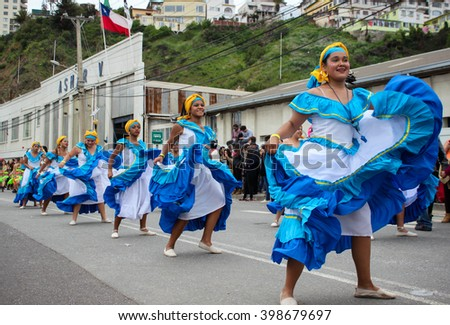 Women are dancing in traditional dress at Mil Tambores Carnaval Valparaiso, Chile 2015-10