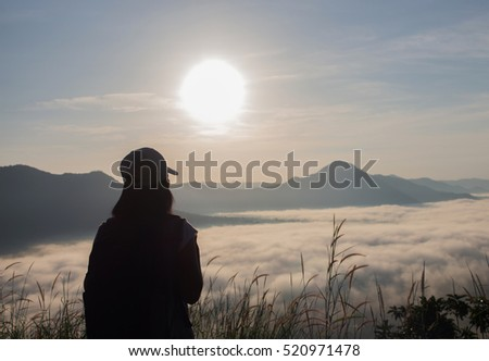 Women are happy looking at the landscape with fog at mountains. with sunrise.