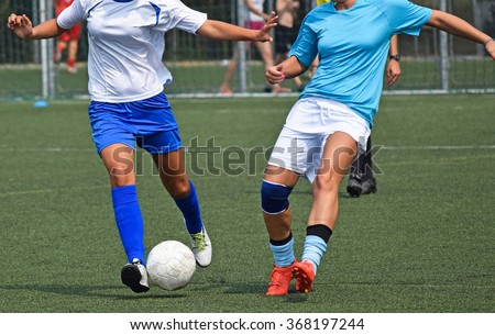 Women are playing soccer - stock photo