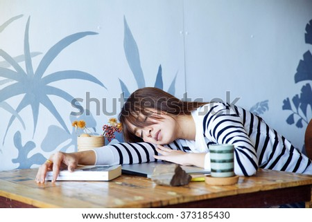 Women Asia working pretty hard work to sleep on the laptop - stock photo