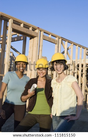 Women  at construction site - stock photo