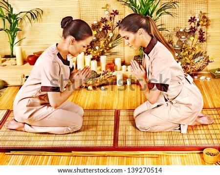 Women at luxury bamboo spa . - stock photo