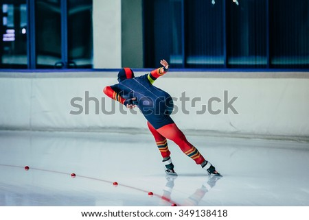 women athlete to sprint speed skating.  speed skating  indoors - stock photo