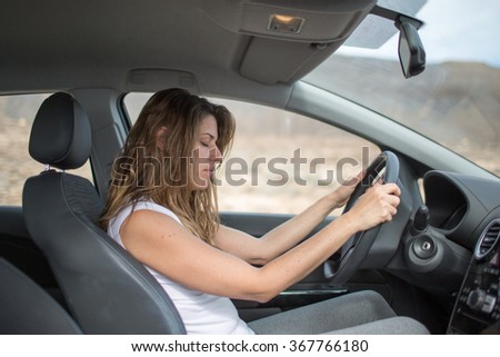 women being tired in car - stock photo