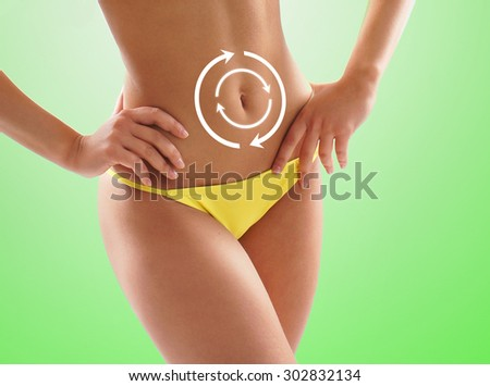 Women belly with the drawing arrows on it isolated on white. Fat lose, liposuction and cellulite removal concept. - stock photo