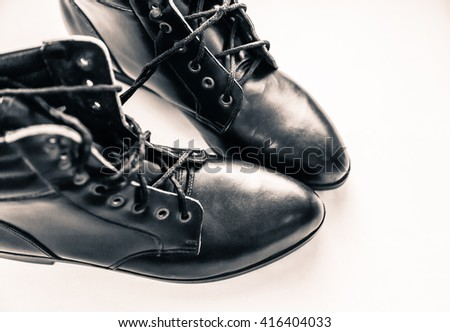 Women boots with laces on a white background