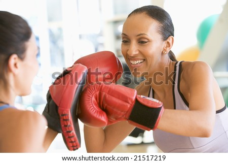 Women Boxing Together At Gym - stock photo