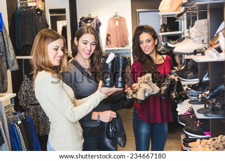 Women Buying Shoes in a Store - stock photo