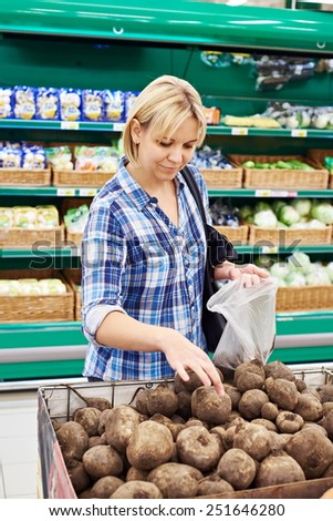 Women buys beets in the store - stock photo