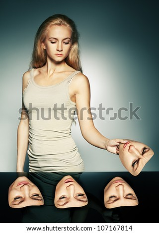 Women choose a mask. Hypocritical, disguise; insincere, two-faced female - stock photo