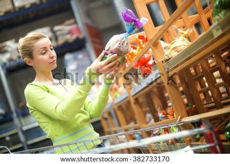 Women choosing bread in supermarket - stock photo