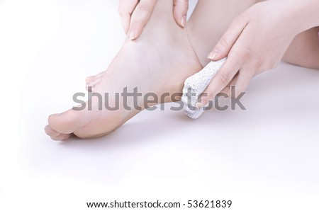 Women cleans her feet, isolated on white