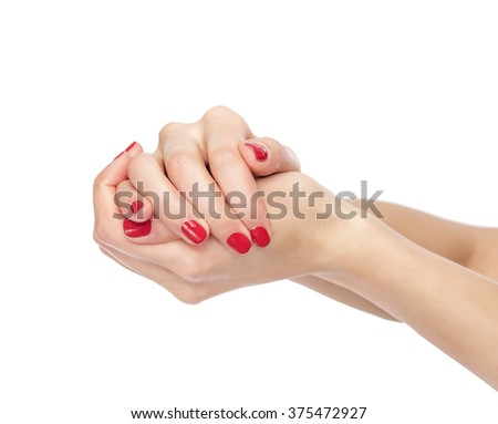 Women clenched hands isolated on white background.