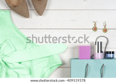 Women clothing set and accessories on a rustic wooden background.Top view, Copy space for text.