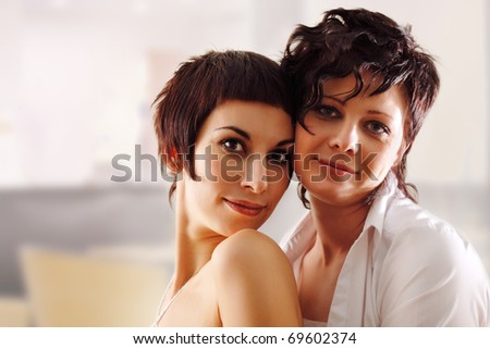 women couple happy attractive at home - stock photo