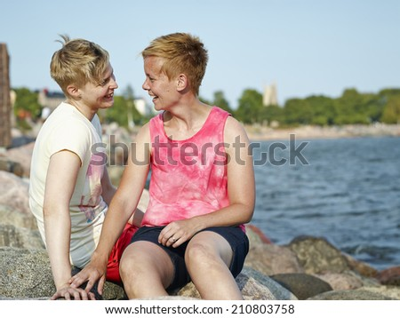 Women couple spend time together at the beach in the afternoon