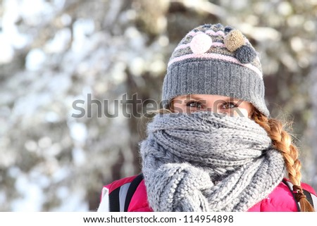 Women covering her face with scarf to keep warm - stock photo