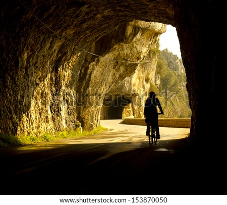 women cycling in tunnel - stock photo