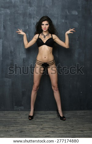 Women dancing in the Egyptian style on blue wall background - stock photo