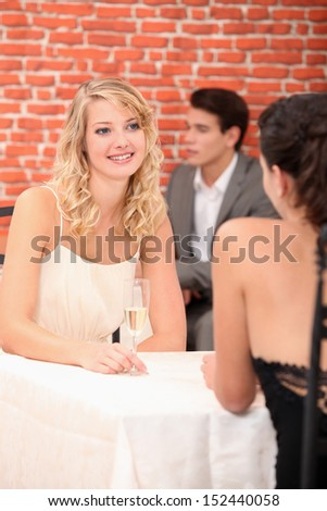 Women dining in a restaurant - stock photo