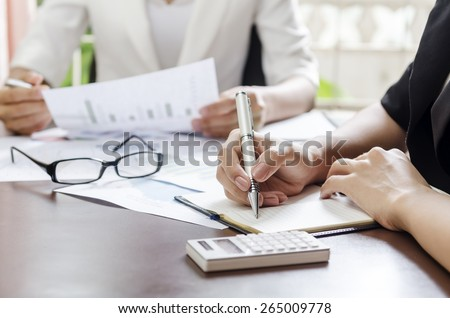 women discussing work in a meeting - stock photo