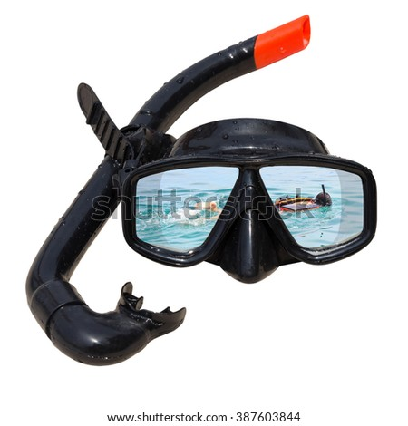 Women diving at ocean is reflected in diving mask and snorkel on the beach. - stock photo