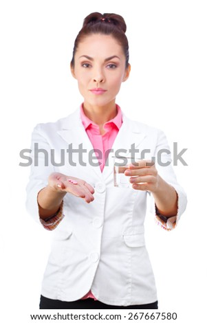Women doctor holding medicine in hand and glass of water.  All isolated on white background. - stock photo