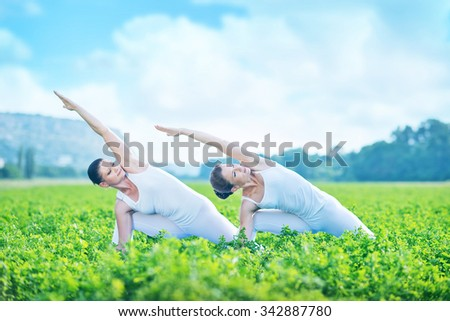 women doing sports outdoors - stock photo