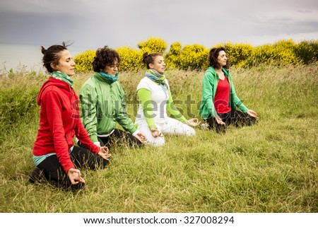 Women doing yoga in a Park - stock photo