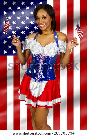 Women dressed up in a costume with the American flag on 4th of July.  The costume has the stars and stripes and the red white and blue flag colors of the USA.