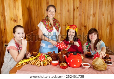 Women drinking tea with russian traditional snack
