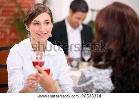 women drinking wine in a restaurant